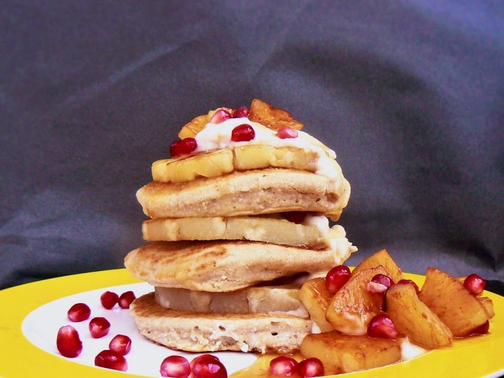 Looking for something a little different this pancake day? Then look no further than these yummy Vegan Coconut & Lime Pancakes.  They are really easy to make and just happen to be Free From Dairy, Egg & Gluten as well as suitable for coeliacs and vegans!  The pancakes are stacked with grilled pineapple slices, big dollops of vegan coconut yoghurt and drizzled with a sticky ginger syrup.   The whole dish makes a very lovely lazy brunch for two - if you feel like sharing that is!