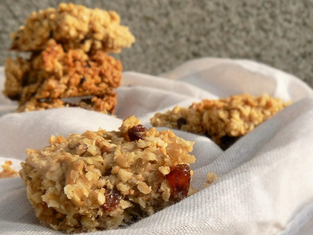 Dairy Free Apple Flapjacks are packed full of fruit but not as sweet as traditional flapjacks. Add a handful of seeds or dried fruit for an extra nutritious snack. And whether you class them as a cake or a biscuit - everyone agrees flapjacks are delicious! These vegan flapjacks are easy to make and have few ingredients. Brilliant for lunchboxes, quick breakfasts and perfect for picnics or afternoon pick-me-ups with tea! #peachicksbakery #veganflapjacks #easyeggfreebaking #noeggs #easydairyfreerecipes #dairyfreerecipe #allotment #dairyfreeflapjacks