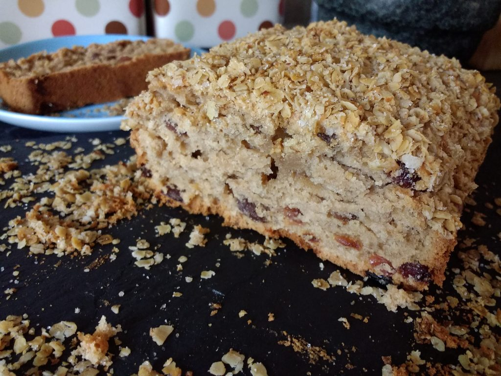 In need of a Lunchbox Lifesaver? Then look no further than this yummy Sultana Tea Loaf! Full of plump juicy sultanas surrounded with a moist, soft sponge and topped with crunchy granola.  Best of all it is Dairyfree, Eggfree, Vegan & will last all week in an airtight tin, so you can bake a batch on Sunday ready for the week ahead!