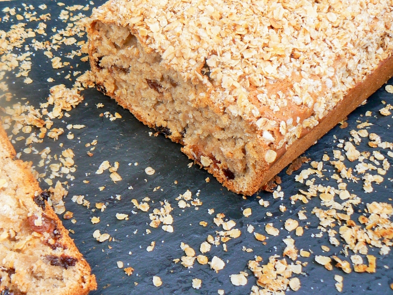 In need of a Lunchbox Lifesaver? Then look no further than this yummy Sultana Tea Loaf! Full of plump juicy sultanas surrounded with a moist, soft sponge and topped with crunchy granola.  Best of all it is Eggfree, Vegan & will last all week in an airtight tin, so you can bake a batch on Sunday ready for the week ahead!