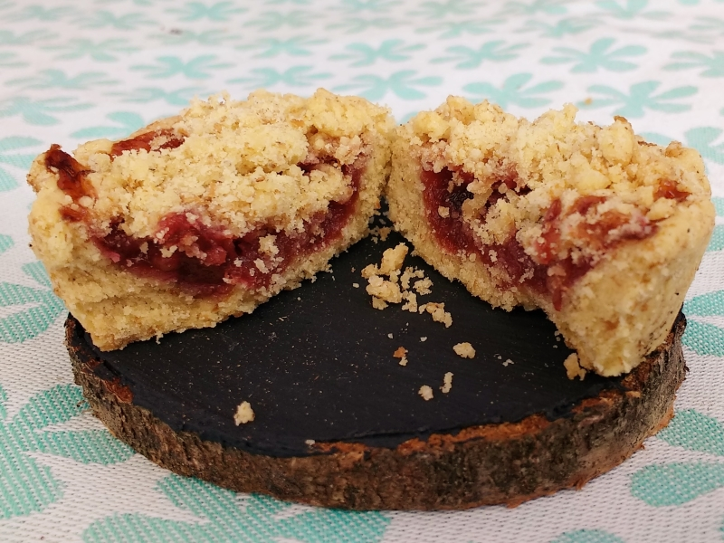 Millie's Jammy Vegan Shortbread Cups with a Crumble Topping make a lovely afternoon treat with your tea or coffee?   A Rich shortbread cup filled with a jam layer hiding under a buttery crumble topping.  *Whispers* AND they are made with wholemeal flour.... but Shhh!!!