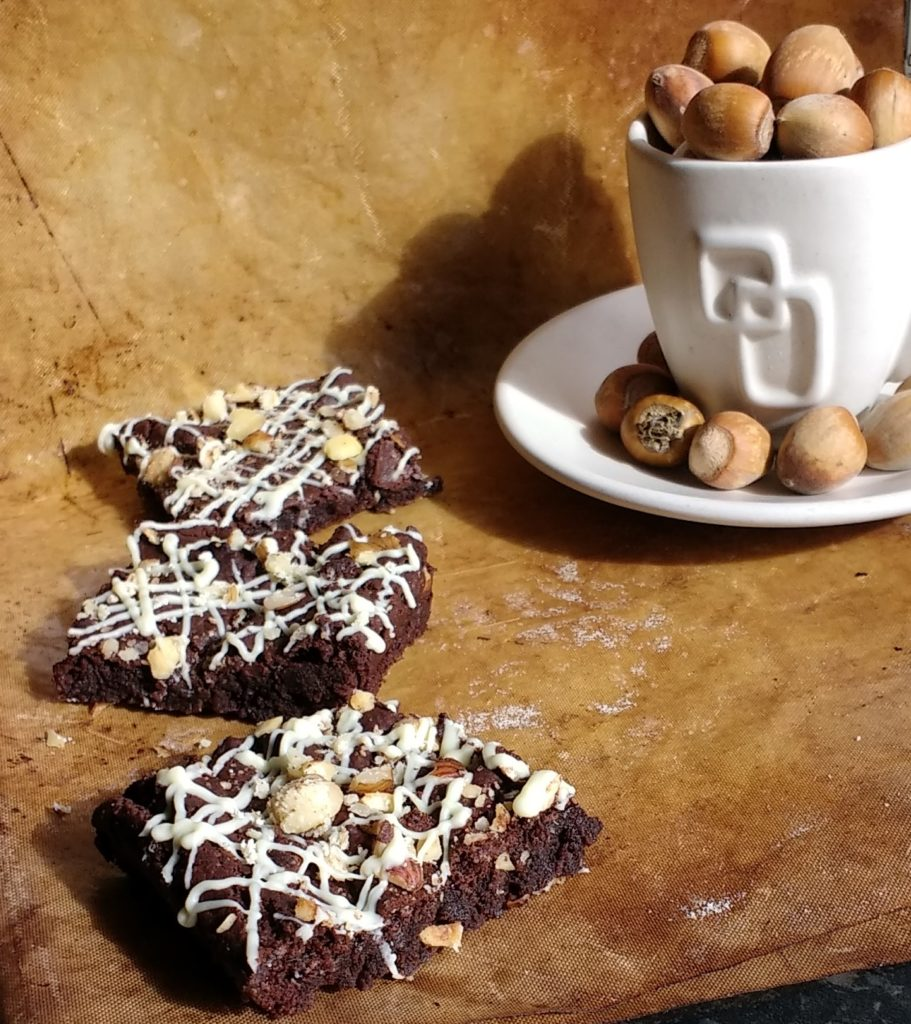 Dark, chewy, Vegan Espresso Brownies with a salty, sweet hazelnut topping. Packs a mighty punch thanks to a strong, shot of espresso! The perfect afternoon pick me up or in Millie's words 'the yummiest things in the whole wide world!' AND they are dairyfree, eggfree and glutenfree too so no-one need miss out on brownies again!