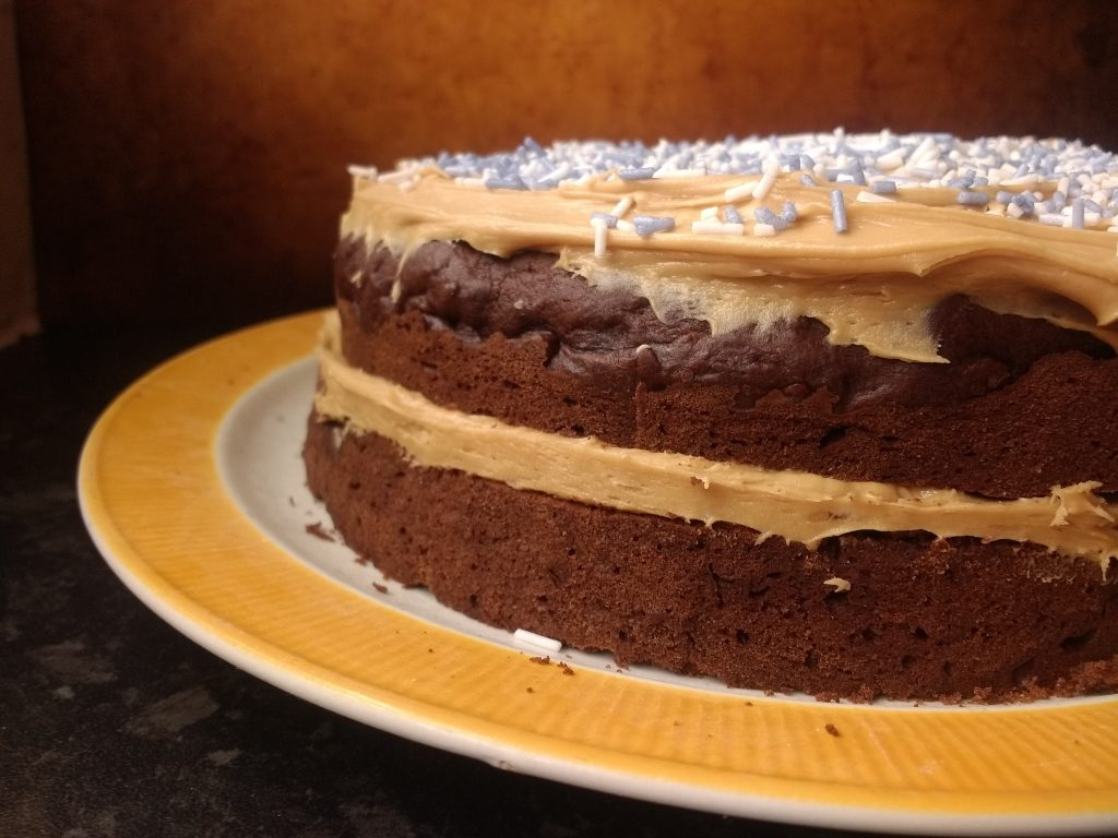 The luxuriously dark and indulgent fudgy chocolate sponge with a creamy coffee buttercream filling make this Ultimate Vegan Chocolate Fudge Cake from @PeachicksBakery a chocolate lover's dream. And IF you decide to share it noone will ever believe you that it is completely #Dairyfree and #Eggfree! #vegan #eggfreebaking #easyeggfree #divinedairyfree
