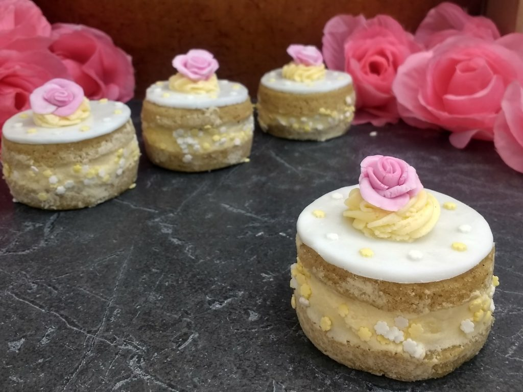 Delicate Individual #Glutenfree #Vegan Lemon & Elderflower Cakes from @Peachicksbakery. Layers of light lemon & Elderflower sponge and a vibrant elderflower buttercream, decorated with a thin layer of fondant and hand-rolled roses. #Top14free #eggfreebaking #easyeggfree