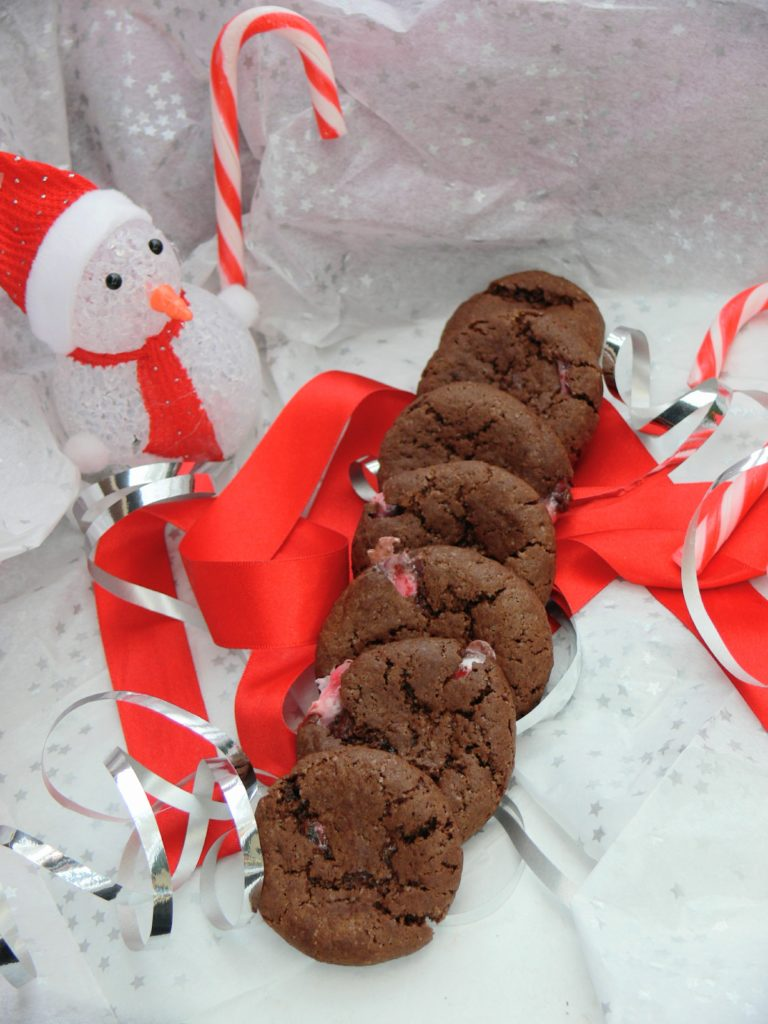 These #Vegan Dark Chocolate Candy Cane Cookies from @Peachicksbakery make great freefrom festive treats. #Dairyfree, #Nutfree and the recipe works just as well with #glutenfree flour. AND they are so simple to make, you can have a batch ready in less than 20minutes! Just add candy eyes, cherry nose & candy cane antlers for cute reindeer cookies.