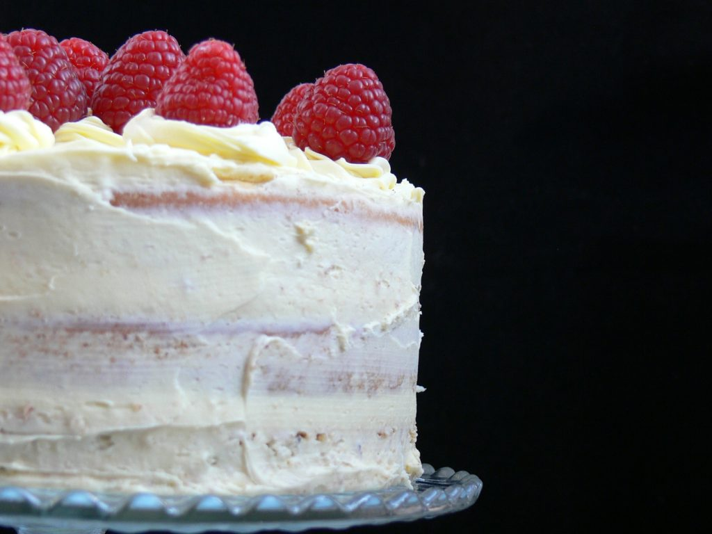 Vegan Lemon & Raspberry Cake, perfect for an elegant birthday tea! Zesty lemon and raspberry sponge layered with luscious lemon buttercream. Easy to adapt to gluten-free too.
