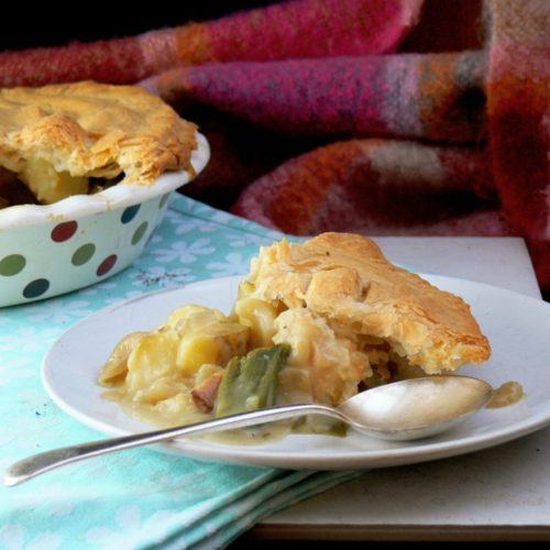 Vegan Leek & Potato Pie, the perfect winter warmer for the whole family. A comforting, hearty vegan pie filled with a rich, creamy dairy free white sauce, chunks of potatoes and beautiful British Leeks. Top with a layer of puff pastry - use ready made or make your own! Dairy Free, Vegan and Gluten Free with suitable pastry!