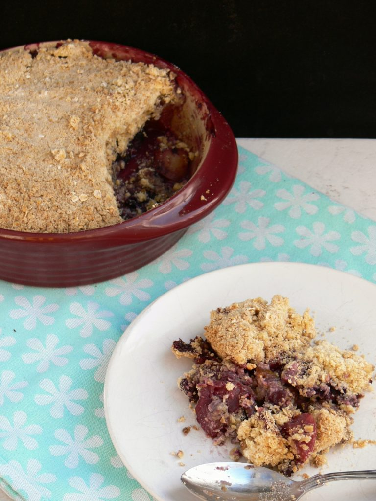Easy Vegan Apple Crumble. Chunks of beautiful British apples, with a hidden layer of jammy blueberries all topped off with a crisp dairy free crumble. Replace the flour with Gluten Free or ground almonds for a comforting coeliac friendly dessert.