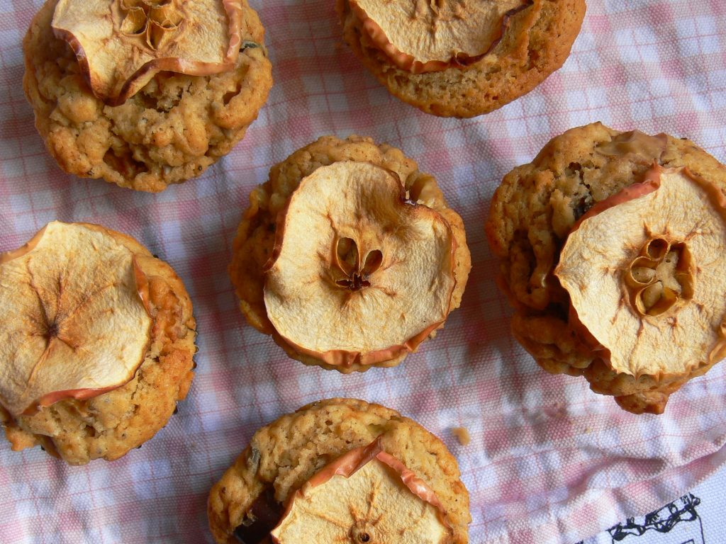Dairy Free, Vegan Apple & Date Muffins great for picnics or mid afternoon pick me ups alike!  Soft, spicy muffins full of juicy apple chunks and chewy date pieces all topped off with pretty apple slices.   Lovely with added hazelnuts for crunch or your favourite seed mix to keep them nut free.  The recipe also works perfectly with Gluten free Flours so no-one need miss out!