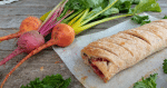 Beetroot Vegan Sausage Rolls with mint are perfect for picnics and lunchboxes alike! Crispy gluten free pastry stuffed with a tasty beetroot quinoa vegan 'sausage' mix. The pretty pink filling is flavoured with beets, vegan feta cheese and fresh mint but can be altered however you like. These hearty vegan beetroot parcels are completely Top14 free and thanks to ready made pastry, a speedy option for any occasion! #bakingwithbeetroot #vegansausagerollrecipe #vegansausagerolls #growyourown #perfectforpicnics #glutenfreevegan #soyfreevegan #freefromonabudget #vegancomfortfood