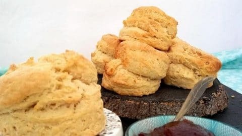 Easy Vegan Scones are an essential part of any afternoon tea and these lovely light and fluffy scones mean noone need miss out!  This basic recipe can be flavoured in anyway you like by just adding a few simple ingredients or keep them plain for a traditional cream tea!  The only question is jam first or cream?