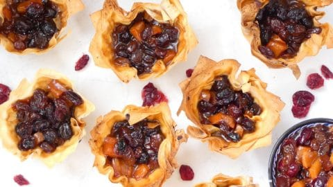 Luxury Vegan Mincemeat with Cranberry & Persimmon. Beautifully simple, homemade vegan mincemeat delicately flavoured with delicious Persimmons. Store cupboard ingredients to show stopping Vegan Mince Pies in a couple of hours using ready made pastry or about half hour if you make the mincemeat ahead of time.  Completely dairy, egg free & suitable for vegans as well as nut free too!