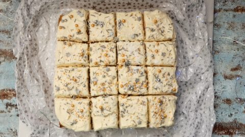 This Easy Vegan Carrot Cake Traybake, filled with juicy sultanas & crunchy sunflower seeds, is smothered with pillows of decadent, dairy free Lemon Cheesecake Frosting.  So simple to make but sure to impress! Sturdy enough to be stacked, filled & covered with fondant for something different on that special occasion.  Free from dairy, eggs, soya, nuts & works beautifully with gluten free flour.
